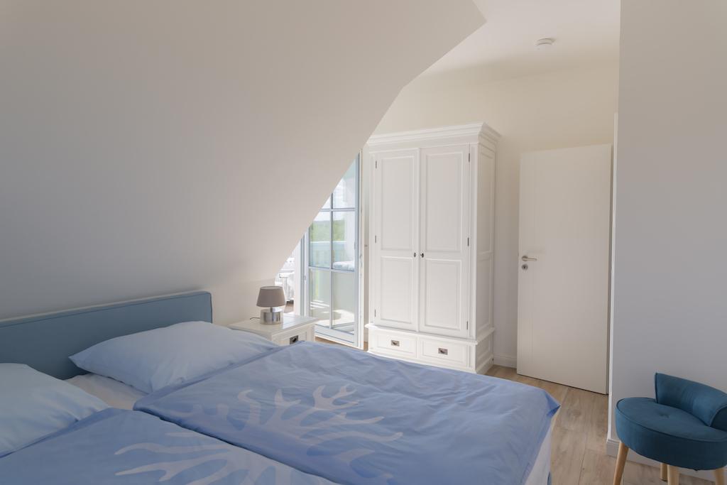 Ferienhaus Nautilus - Schlafzimmer in meerblauen Farbtönen